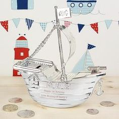 This silver plated Pirate Ship Money Box can be engraved with any message over 2 lines and up to 20 characters per line.Money Box has a plastic swivel stopper.Ideal for Birthdays, Christmas presents, Christening gifts