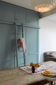 Bespoke Shaker cupboards in 'Trinity Blue' with a beautiful ladder to match