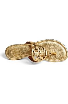 Free shipping and returns on Tory Burch 'Miller' Flip Flop (Women) at Nordstrom.com. A big, bold signature Tory Burch logo medallion adds panache to an easy flip-flop cast in shimmery metallic leather.
