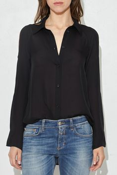 - 100% Silk - Collared placket - Shoulder cut-outs - Sheer - Model is 5'9'' and wears a size T0.