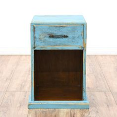 This nightstand is featured in a solid wood with a distressed sky blue chalk paint finish. This shabby chic style bedside table has a single spacious drawer, ornamental handle pull, and bottom shelf. Perfect for storing bedtime necessities! #shabbychic #dressers #nightstand #sandiegovintage #vintagefurniture
