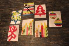 Zelfgemaakte kerstkaarten van gekleurd tape.