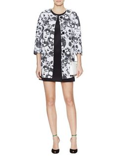 Almost looks like an abstract print from a distance!  I like the classic silhouette with the twist of a skull brocade fabric.