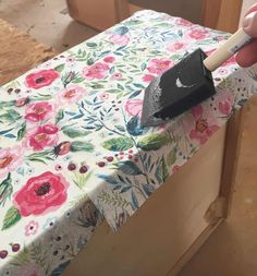 Learn how to decoupage furniture. This tutorial walks you through using paper napkins to add pattern to a dresser to create a floral decoupaged dresser.
