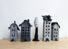 Four grey buildings of felt with a tree. Miniature. by Intres
