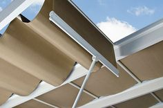 ShadeTree solid beige retractable fabric canopy showing wand used to adjust canopy