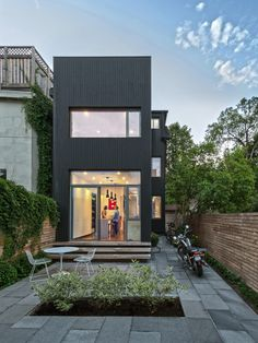 The house narrows at the back before leading out to a small courtyard. While the home isn't exposed to a great deal of natural light, the firm incorporated windows where possible to enhance the flow of sunlight throughout the space.   - ELLEDecor.com