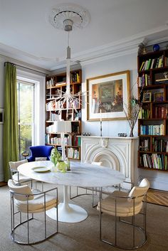 Eclectic Dining Room in Brooklyn, NY by Fawn Galli Interiors