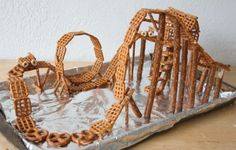 Genius pretzel roller coaster for at least an hour (or more!) of fun. Use all kinds of crunchy snacks. #winterbreak