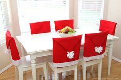 """"""" DIY Christmas Chair Covers What a fantastic DIY idea to bring life to any kitchen or dinning table! This DIY Christmas Chair Covers will not only bring the holiday spirit to any room but. Christmas Centerpieces, Christmas Decorations To Make, Holiday Crafts, Christmas Ornaments, Homemade Christmas, Simple Christmas, Diy Christmas, Minimalist Christmas, Christmas Chair Covers"""