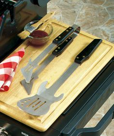 Guitar-Shaped BBQ Grilling Tools I already have a guitar shaped spatula but I dont think i can use it on the grill.. this is neat