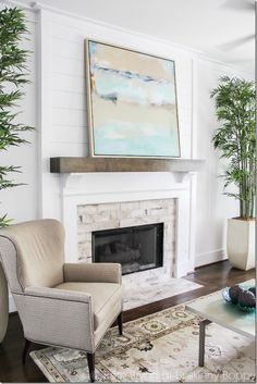 Keep it simple and sophisticated with a large scale piece of art that fills the wall above the fireplace.