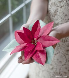 RedPaperPoinsettia via Lia Griffith  **wish I had this last year with my sad attempt at making poinsettias!