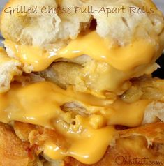 Grilled Cheese Pull-Apart Rolls Recipe ~ Says: stuff obscene amounts of Cheese into Biscuit Dough, roll it into balls, drench it in Butter and bake them until this happens... Gooey balls of Grilled cheese-like orbs, baked to a puffed perfection!