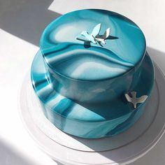 Are you ready for mirror glaze cakes? Could this be the new darling of the wedding cake world? From what we can gather, the cakes are made in a mold and the glaze is achieved by pouring a gelatin mixture over the top. Olga Noskova who is based in Ufa, Russia became an instagram sensation ten …