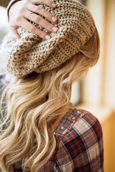 With a knitted beanie bad hair days never looked so good.