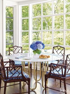 Modern Neutral Living Room with Large Floral Photograph | LuxeSource | Luxe Magazine - The Luxury Home Redefined Jonathan Adler round dining table breakfast room