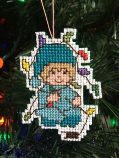 New Handmade Cross Stitch Christmas Ornament-Boy in Pajamas Tangles in Lights FOR SALE • $8.00 • See Photos! Money Back Guarantee. Brand new handmade cross stitch Christmas ornament. Little boy in blue pajamas tangled in lights. Stitched on 14 count white Aida with cotton thread in blue, gold, peach, yellow, green, 122348842009