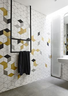 Add a pop of colour to your bathroom tile design with geometric tiles Yellow Bathroom Decor, Modern Bathroom Tile, Yellow Bathrooms, Bathroom Tile Designs, Bathroom Interior, Bathroom Wall, Remodel Bathroom, Bathroom Remodeling, Remodeling Ideas