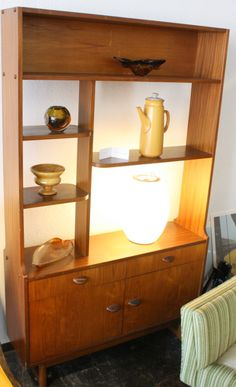 Small room divider with rounded shelves