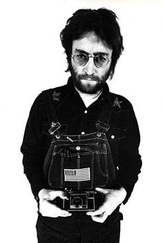 John Lennon with Instamatic by Annie Leibovitz (1970)