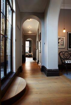 light grey walls - black trim - black doors - wooden floors