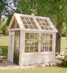 Greenhouse / garden shed created from old windows that were removed from a… Old Window Greenhouse, Greenhouse Shed, Greenhouse Growing, Small Greenhouse, Greenhouse Gardening, Portable Greenhouse, Indoor Greenhouse, Greenhouse Wedding, Dream Garden
