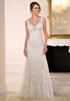 Gorgeous column-style wedding dress handcrafted with stunning detail. Made from vintage inspired lace and soft tulle over satin. Fabric: Lace, Tulle, Satin