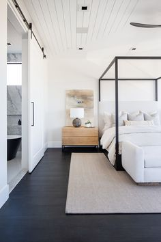 Dark floors, black canopy bed frame, and creamy neutral tones. this bedroom by is sending us into the weekend with all kinds of Modern Master Bedroom, Master Bedroom Design, Dream Bedroom, Home Bedroom, Modern Bedroom Design, Bedroom Ideas, Master Bedrooms, Modern Canopy Bed, Bedroom Makeovers
