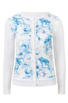 Part of the blue floral range, our cardigan features a scoop neck with pearl front button up fastening. The blue floralcardigan is an uptake from our previous knitwear which strikes the balance between statement style and wardrobe versatility. It's crafted from a wool mix with an opaque floral overlay adding to its unique form.  Printed front panel. Button front. Slim fit. Model is 5'8 and wears a UK 8. Hand wash.