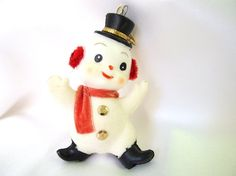 Vintage plastic Christmas ornament is a white flocked snowman. The waving…