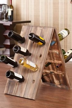 Store your wine in this distinctive rack crafted from solid fir wood with a sleek weathered oak finish and the ability to hold up to 24 bottles in a convenient, decorative display. Wine Racks, Riddling Rack, Bottle Rack, Weathered Oak, Distressed Wood, In Vino Veritas, Wine Storage, Storage Ideas, Loft Style