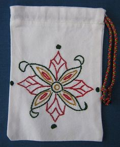Cute little pouches/bags with hand embroidered patterns are perfect for holding gift cards, jewelry or other small gifts and Wedding Favor Bags.  Pouch measures 16,5cm X 13,5 cm and has a drawstring ribbon closure. This bag is off-white with a hand embroidered Cretan design from 14th century. Ribbon color may vary but if you have a specific request please let me know. Bags can also be personalized. Other sizes and patterns are available. Convo me if you are interested. See my listings fo...