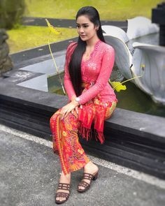 There can be no excess to love, none to knowledge, and none to beauty - Cynthia Aurellia.Image may contain: 1 person, standing and outdoor Beautiful Hijab, Beautiful Asian Girls, Beautiful Outfits, Model Kebaya Modern, Bali Girls, Kebaya Bali, Myanmar Women, Indonesian Girls, Sarongs