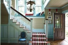 In the entry hall, the Louis XVI fauteuil is from Doyle New York, the stair runner is by Beauvais Carpets, and the walls are painted in Pratt & Lambert's Bleu Passe. Porches, Tuxedo Park, Zen, Farmhouse Side Table, Park Homes, Entry Hall, Farmhouse Design, Elle Decor, Room Inspiration