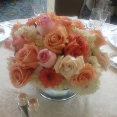 Dahlia and garden rose centerpiece at the Boston Harbor Hotel ... Love coral, pinks and peaches !