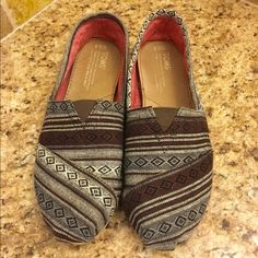 Used Toms Multi Colored Toms - (brown, gray, black) no rips/tears. Great Condition! Minor ware. 8.5 Wide TOMS Shoes Flats & Loafers