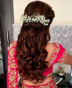 Indian bridal hairstyles inspiration | Dutch braid adorned with baby breath flowers | Half updos | Soft curls | Mehendi look and hairstyles | Hairstyles ideas for Indian brides | Bridal accessories | Credits: Ritika Hairstylist | Every Indian brides Fav. Wedding E-magazine to read. Here for any marriage advice you need | www.wittyvows.com shares things no one tells brides covers real weddings ideas inspirations design trends and the right vendors candid photographers etc…