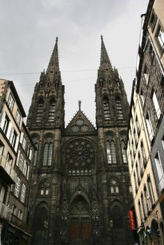 Clermont Cathedral (La Cathédrale de Notre-Dame de l'Assomption, Clermont-Ferrand) is a striking Gothic edifice built of black lava stone in the 13th and 14th centuries. It contains beautiful medieval stained glass windows, many Gothic wall paintings, and a 10th-century crypt.