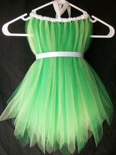 "Tinkerbell costume! This link should go to an etsy store. But, the dress is ""no longer available"". However, this is very DIY with the same technique as making your own tutu...just make the ""tutu"" part really long and ""wrap it"" with white ribbon and finish with he same white ribbon for a ""belt"" :)"