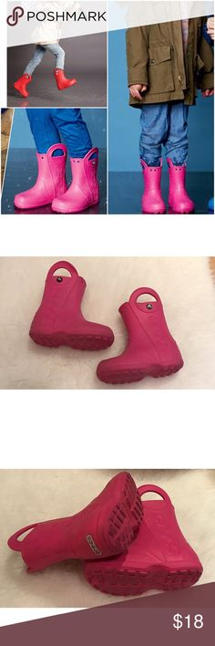 Cute Girls Crocs Pink Top Handle Rain Boots Still in good pre-loved condition Pink too handle rain boots from Crocs in Toddler Girl size 11. Normal wear on soles and minor marks on the outside. You probably can just wipe them clean or a gentle brushing yo get them off. ❌No trades or modeling. Open to reasonable offers. Thank you‼ CROCS Shoes Rain & Snow Boots