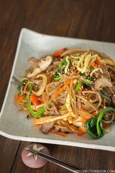 Japchae 잡채 (Korean Stir Fried Noodles) - Have you tried Japchae (Korean sweet potato noodles stir fried with vegetables and meat)? This recipe will show you how easy it is to cook up this beloved Korean noodle dish at home! #japchae #koreannoodles #japchaerecipe | Easy Japanese Recipes at JustOneCookbook.com Korean Sweet Potato Noodles, Korean Glass Noodles, Asian Noodles, Japanese Noodles, Easy Japanese Recipes, Asian Recipes, Ethnic Recipes, Japanese Food, Korean Dishes