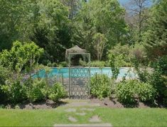 Betsey Johnson's backyard pool is tucked away behind the greenery that surrounds it.