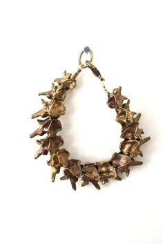 Jewels made out of recycled bullet cases by Bones and feathers collective, FW2011 collection.