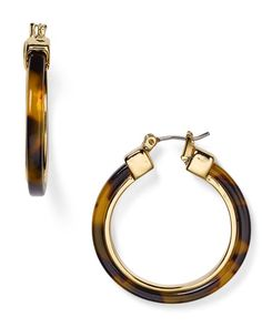 "Faux tortoise shell lends a pop of pattern to Lauren Ralph Lauren's classic hoop earrings. | Imported | 1.25"" diameter 