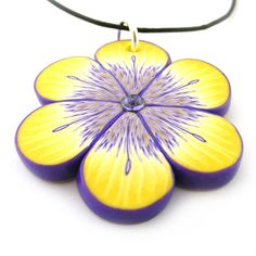 Items similar to Flower Pendant Polymer Clay Yellow and Purple on Etsy Polymer Clay Projects, Polymer Clay Creations, Polymer Clay Jewelry, Shades Of Yellow, Purple Yellow, Purple Gold, Lavender Lemonade, Yellow Cottage, Malva