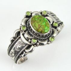 Cuff | Mona Van Riper (Anglo).  Sterling silver, with Carico Lake Turquoise stone and smaller peridot gems.