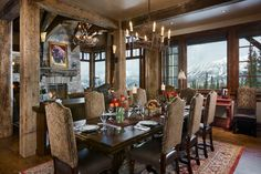 I like the chairs, the chandeliers, the exposed timbers, stone fireplace, elegant but cozy feeling
