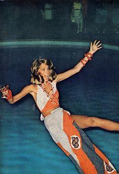 Jumping into a pool Helmut Newton style.- http://www.destinationluxury.com
