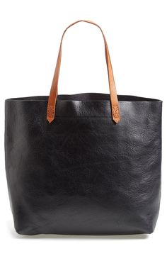 The brown and black leather color combo of this Madewell tote are perfect for the fall and winter season.